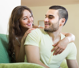 Adult couple on sofa in home