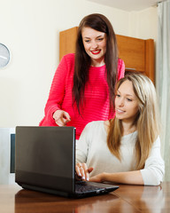 Happy women with laptop