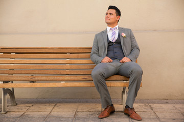 Groom sitting on a bench