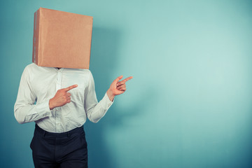 Man with box on head is pointing