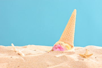 Studio shot of an ice cream splashed on sand