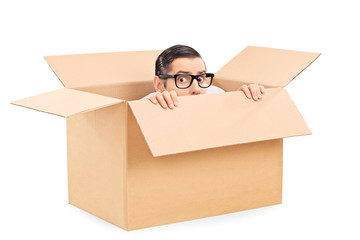 Scared man hiding in a carton box