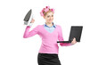 Happy woman holding a laptop and an iron