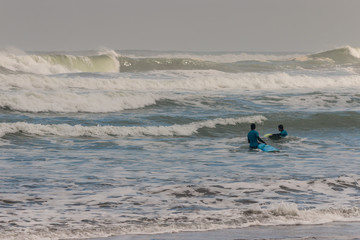 surfers waiting for waves