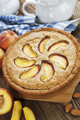 Pie with peaches and almonds