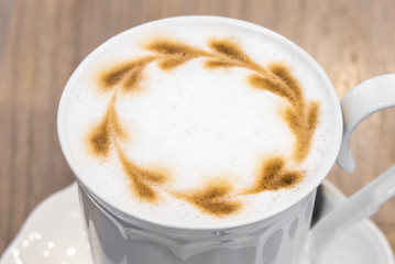Coffee Lovers,Milk foam in Cappuccino coffee in white cup