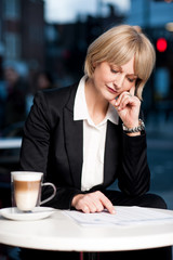 Thoughtful business woman in cafe