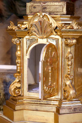 precious gold Tabernacle with door open in a Church