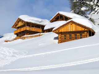 chalets in the middle of the snow high in the italian Dolomites