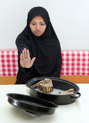 Woman refuses pork