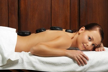 Beautiful girl having a stone therapy