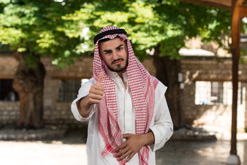 Modern Arabic Businessman Holding Thumbs Up
