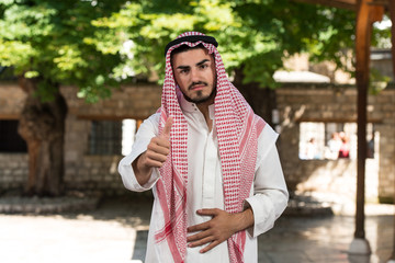 Handsome Middle Eastern Holding Thumbs Up
