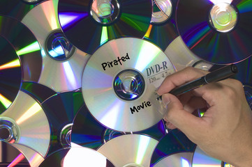 Pirated Movie labeled on yellow DVD piled