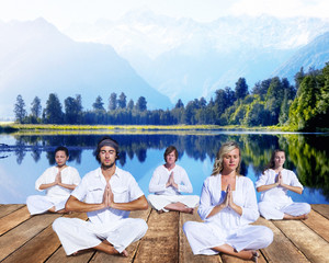 Group of People Doing Meditation near Mountain Range