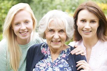Female Multi Generation Portrait In Garden