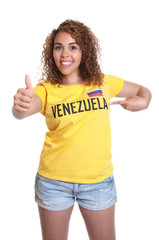 Young woman from Venezuela pointing at shirt