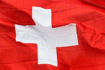 Swiss flag in the wind in the sunshine
