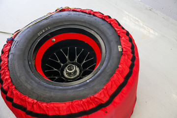 Race car wheel on track