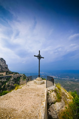 Cross on the cliff Montserrat mountain