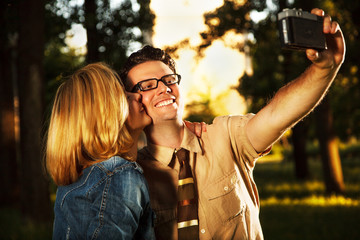 Happy young couple taking self-portrait
