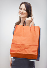 Happy woman hold shopping bag.Young model