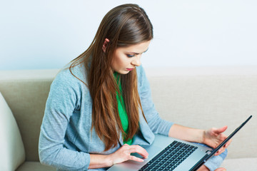 Young woman working at home. Computer, laptop.