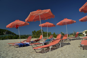 orange umbrellas - karavostasi beach parga greece