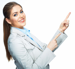 Smilinf business woman pointing on space. Isolated white