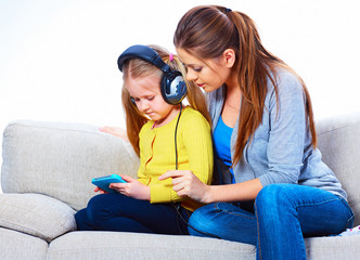 Family couple, mother and daughter play with tablet PC.