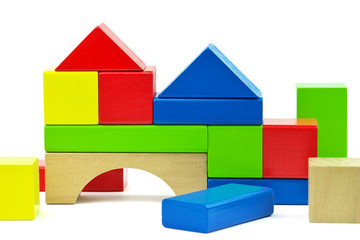 House made from toy wooden colorful building blocks