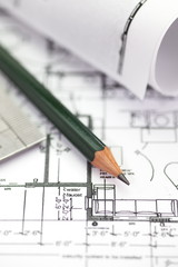 Architect rolls and plans construction project drawing