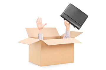 Man stretching his hands out of a box