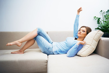 Young woman sofa lying