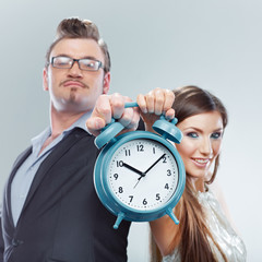 Business woman and business man hold watch.