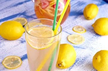 Pitcher of lemonade with lemons, and fresh