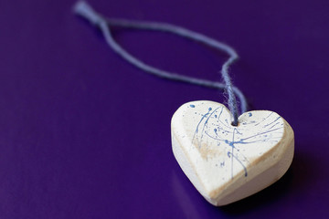 Wooden heart close-up on blue background