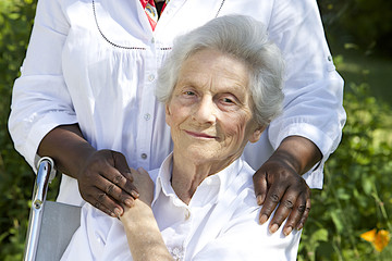 Symbol of comfort and support from care giver to elderly woman