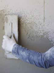 Worker performs internal plaster