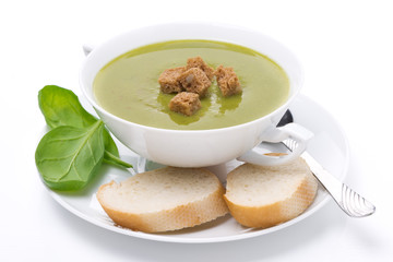 delicious spinach soup with croutons, isolated