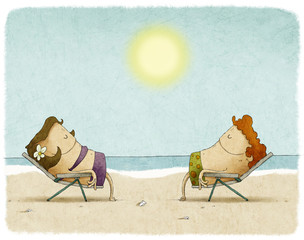 Couple sunbathing on deck chairs