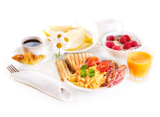 healthy breakfast with scrambled eggs, juice and fruits