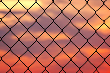 metallic fence at sunset
