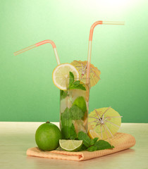 Cocktail glass, umbrellas, juicy lime and napkin