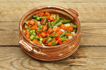 vegetables in clay bowl