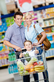 Family drives cart with food and boy sitting there