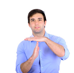 Portrait of handsome young man gesturing time out sign isolated