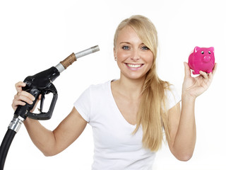 Woman with fuel nozzle and piggybank