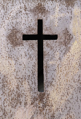 Old rusty metal cross