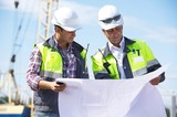Two Engineers At Construction Site